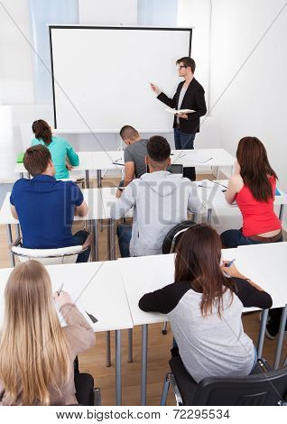 Teacher Teaching College Students In Classroom
