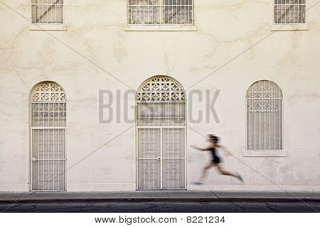 Fast Running Woman On A City Street.