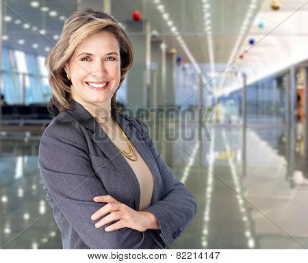 Mature business woman on modern office background.