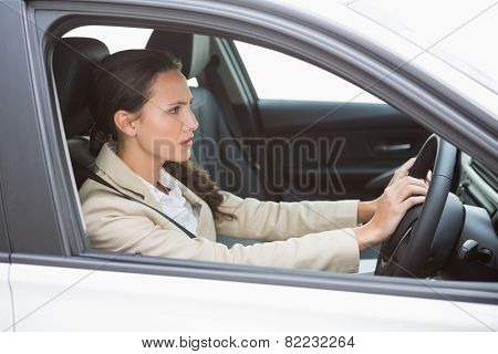 Businesswoman honking the horn in her car