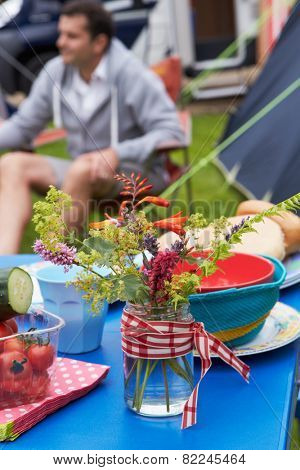 Wild Flowers Decorating Table On Family Camping Holiday
