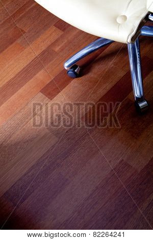 close up image of leather office chair on a floor