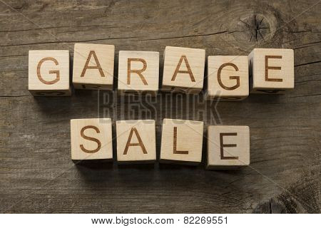 Garage Sale text on a wooden background