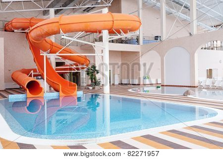 Orange waterslide, indoor pool poster