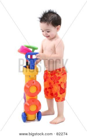 Boy Playing With Plastic Golf Set Over White
