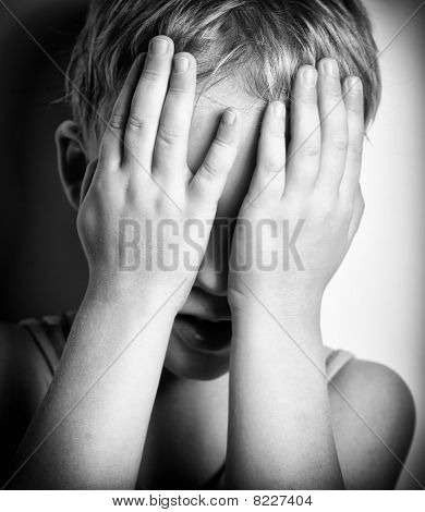Bw Portrait Of Sad Crying Little Boy Covers His Face With Hands