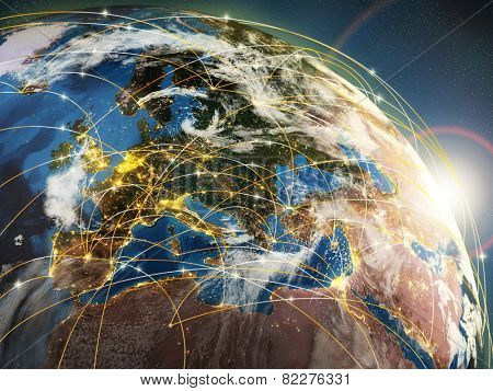 Globalization or communication concept. Earth and luminous rays symbolizing network or airlines. 3d  Elements of this image furnished by NASA