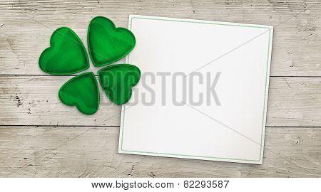 Four leaf clover on wood