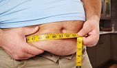 Fat belly. Man with overweight abdomen. Weight loss concept. poster