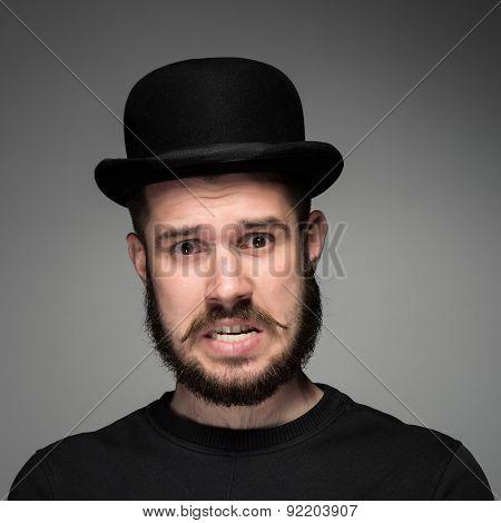 Portrait of young indignant man in studio