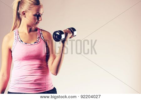 Woman Standing Straight Doing Bicep Curl.