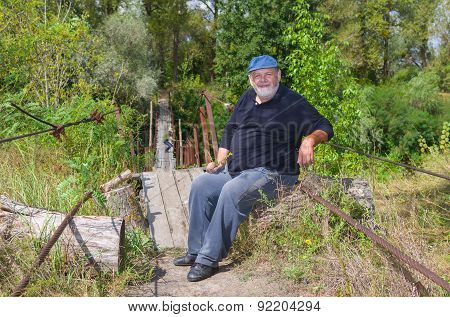 Man having rest at the foot-bridge