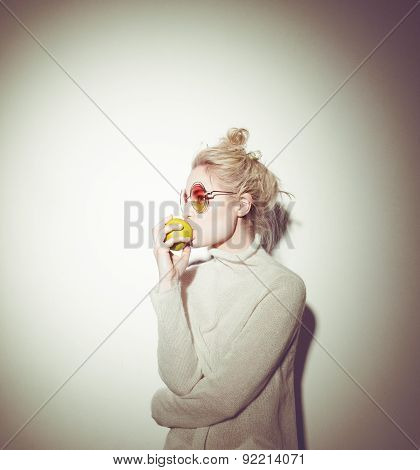 blond woman with green apple holding apple hipster version  bible Eva