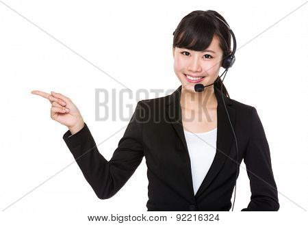 Telemarketing concept, businesswoman with headset and finger pointing selling something
