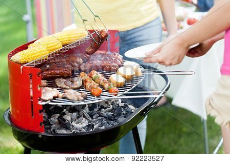 Host Serving Woman Grilled Sausage