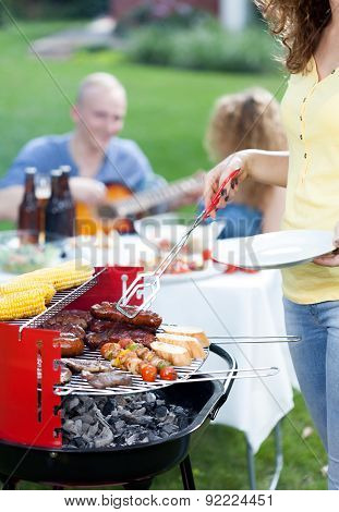 Barbecue Party In Garden