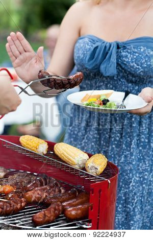 Woman Being On Diet Refusing Sausage