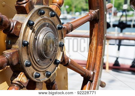 Steering Wheel  Of Wood On A Tall Ship