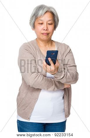 Asian old woman read on the smartphone