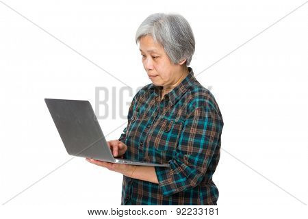 Old woman use of notebook computer