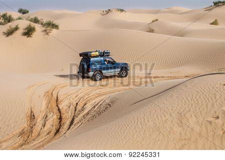 4X4 Vehicle Drives Around The Sand Dunes Of The Sahara Desert.