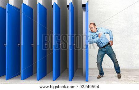 businessman try to farce door