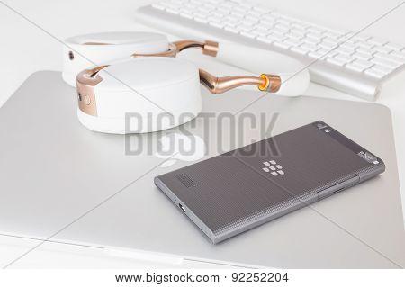 BlackBerry Leap smartphone back, Apple MacBook Pro Retina and Parrot Zik ear-flaps