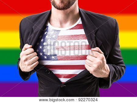 Businessman stretching suit with USA flag with rainbow flag