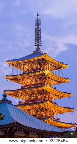 Japanese red pagoda in Asakusa temple at twilight