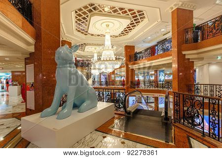 MONTE CARLO, MONACO - JULY 13, 2013: Interior view of Metropole Shopping Center - contains 80 luxury shops and boutiques and is one of the popular tourist places to visit in Monte Carlo.