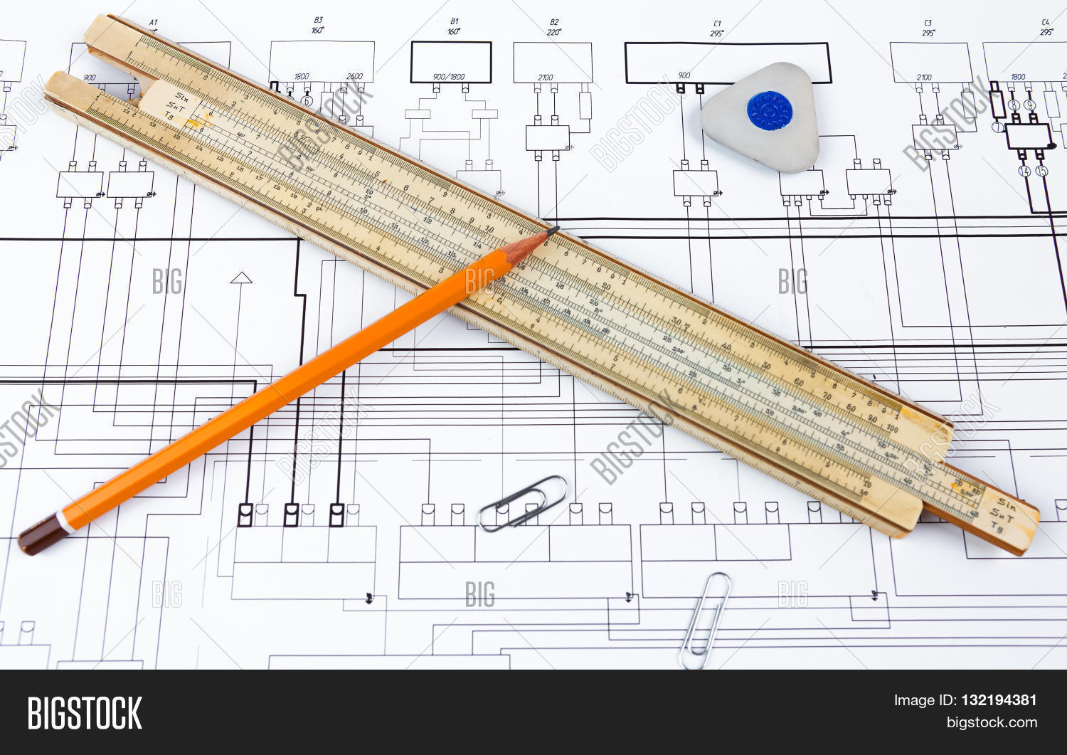 Professional scale ruler pencil image photo bigstock professional scale ruler pencil eraser and some staples on the blueprint malvernweather Choice Image