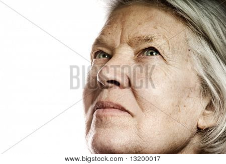 Elderly woman's portrait. Isolated on white background