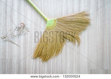 top view of a broom and Dustpan old with dust in living room,select focus