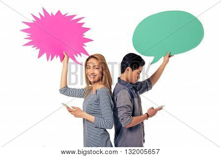 Couple With Speech Bubbles And Gadgets