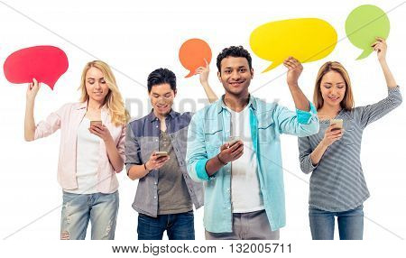 Students With Speech Bubbles And Gadgets