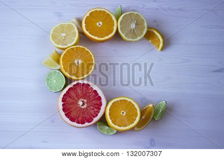 Products containing vitamin C isolated on wooden white background