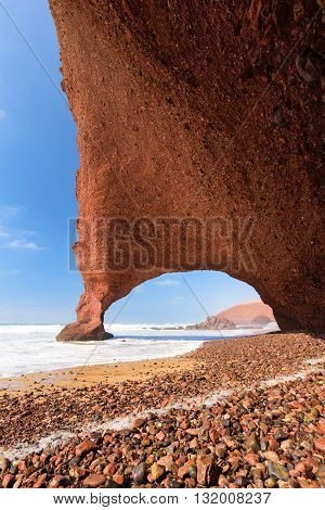 Red arches and rocky beach at the Atlantic Ocean in the region Sous-Massa-Draa, Legzira, Morocco, Africa