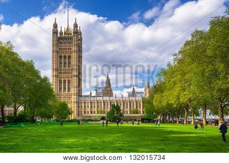 LONDON, ENGLAND - May 14, 2016: Architecture of the Westminster Palace in London, UK. The Palace of Westminster commonly known as the Houses of Parliament is the home of the Parliament of England.