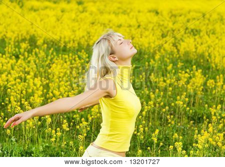 Beautiful young woman in a flower field