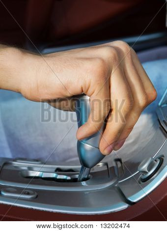 Driver's hand changing speed