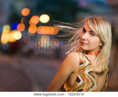 Beautiful sad girl in the city at night