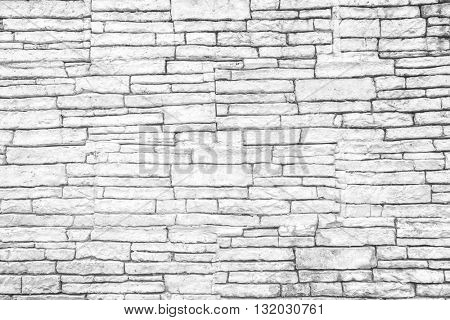 Abstract weathered texture stained old stucco light gray and aged paint white brick wall background, grungy rusty blocks of stonework technology color horizontal architecture wallpaper