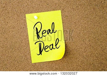 Business Acronym RD Real Deal written on yellow paper note pinned on cork board with white thumbtack copy space available poster