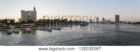 Cairo Egypt - May 26 2016: Panoramic view of party boats docked on the Nile river on the island of Zamalek in central Cairo.