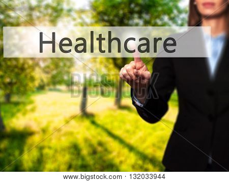 Healthcare - Businesswoman Hand Pressing Button On Touch Screen Interface.