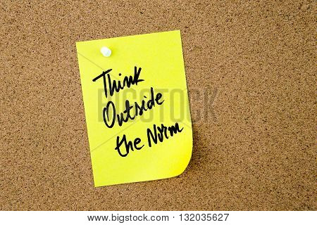 Think Outside The Norm Written On Yellow Paper Note