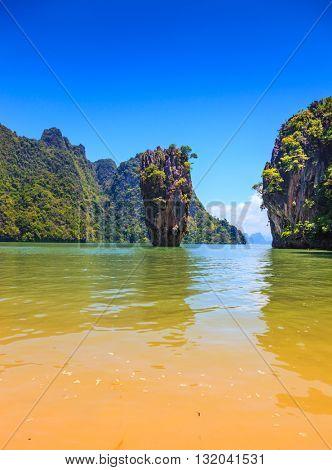 Calm and warm bay and bizarre island. James Bond Island. The tourist season in Thailand