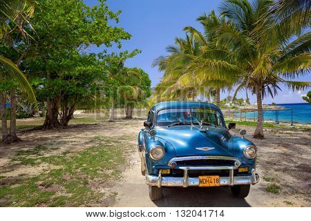 VARADERO, CUBA - MAY, 22, 2013: Blue american classic car on the beach