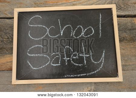 School safety written in chalk on a chalkboard on a rustic background