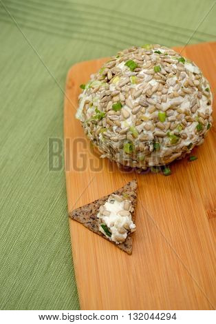 Gourmet Vegan Cheese Ball with dollop on a chip